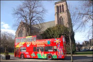 CitySightseeing bus at Inverness cathedral
