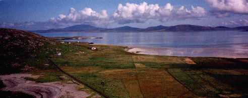 Photo from Dun Scurrival overlooking Eoligarry, Eriskay and South Uist